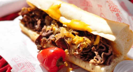 Eat Philly cheesesteak in Philly